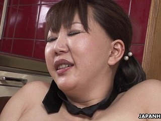 Chubby Japanese MILF moans while her hairy pussy is toyed