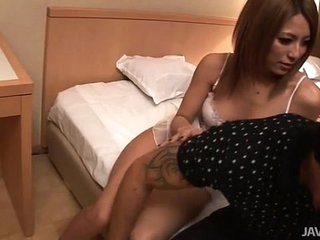 Two busty Japanese dolls fuck a horny guy in a guest-house yard