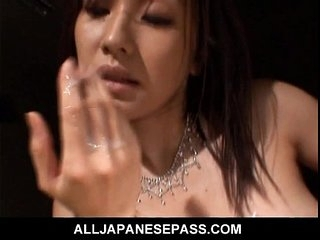 Japanese MILF titty-fucks for a taste be fitting of cum