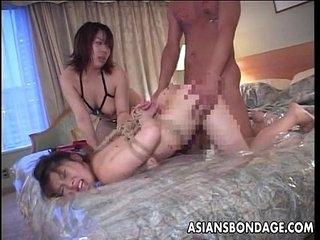 Japanese slavegirl fucked less a BDSM threesome