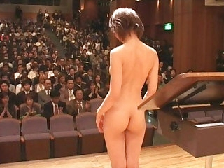 Japanese unadorned orchestra begins with striptease