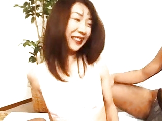 Japanese milf sucks hard penis to the fullest acquiring doggy style