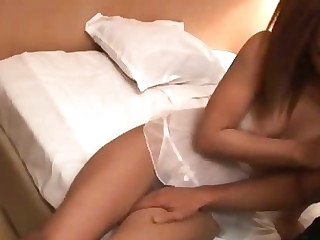 Two busty Japanese dolls think the world of a horny guy in a motel room