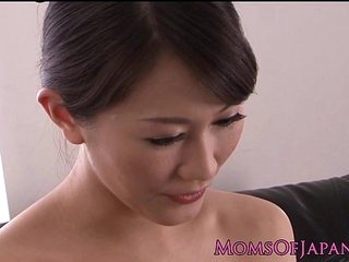 Petite Japanese milf rubs will not hear of sweet clit